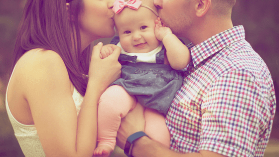 a couple with their cute baby