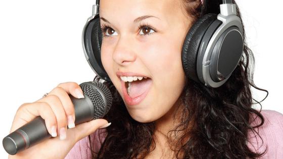 a woman singing in a karaoke