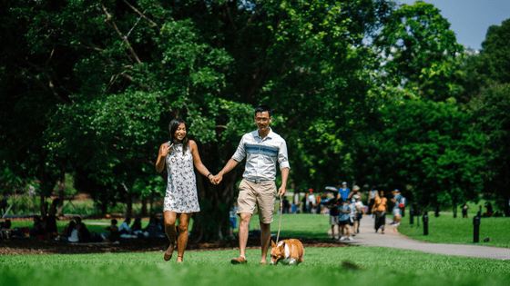 a filipino couple walking together in the park