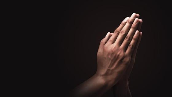 A praying Filipino guy
